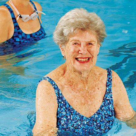 Woman enjoying aquatics water fitness class