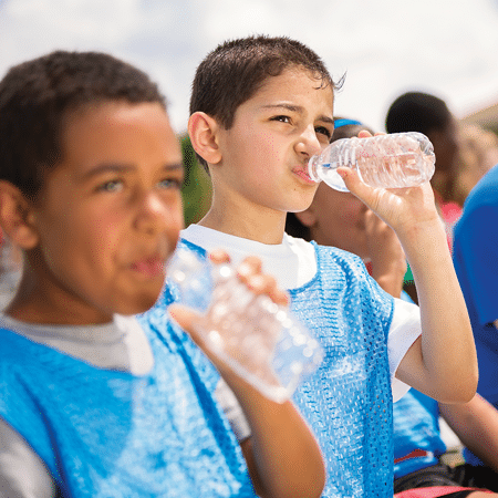 Young boys drinking water during sports timeout
