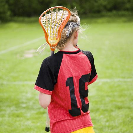 Girl in lacrosse uniform