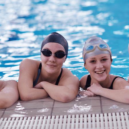 Teens swimming in pool
