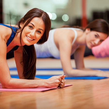 Women planking in yoga class